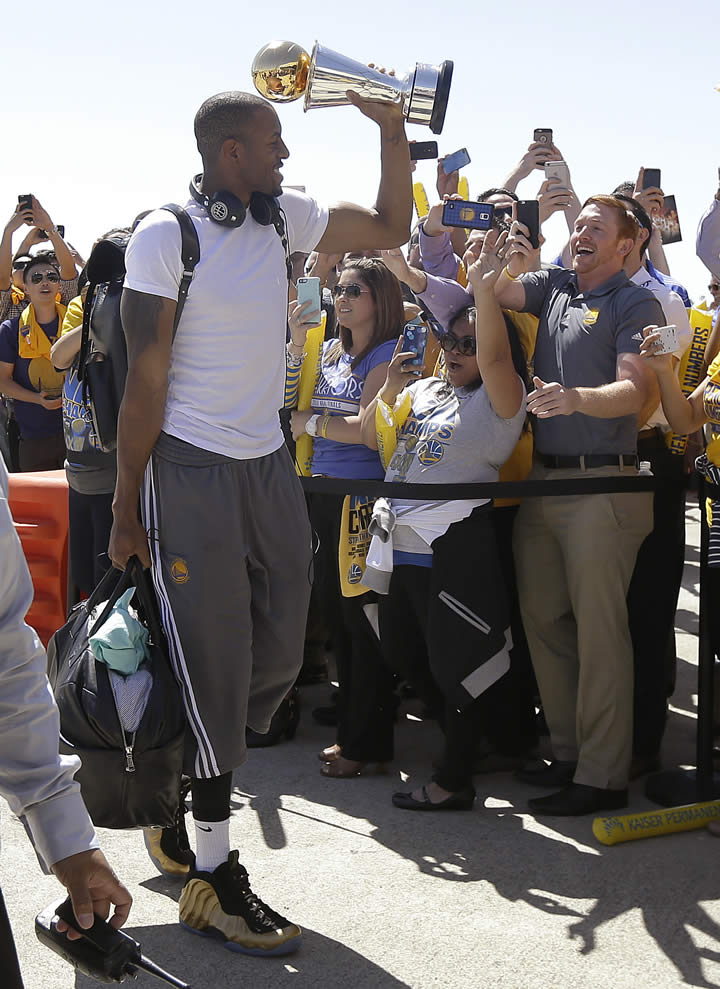 <div class='meta'><div class='origin-logo' data-origin='none'></div><span class='caption-text' data-credit='AP Photo/Jeff Chiu'>Golden State Warriors forward Andre Iguodala lifts the NBA Finals MVP trophy as he walks past team employees in Oakland, Calif., June 17, 2015.</span></div>