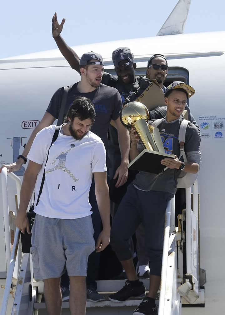 <div class='meta'><div class='origin-logo' data-origin='none'></div><span class='caption-text' data-credit='AP Photo/Jeff Chiu'>Warriors guard Stephen Curry carries the championship trophy next to Andrew Bogut, David Lee, Draymond Green, and Shaun Livingston in Oakland, Calif., Wednesday, June 17, 2015.</span></div>