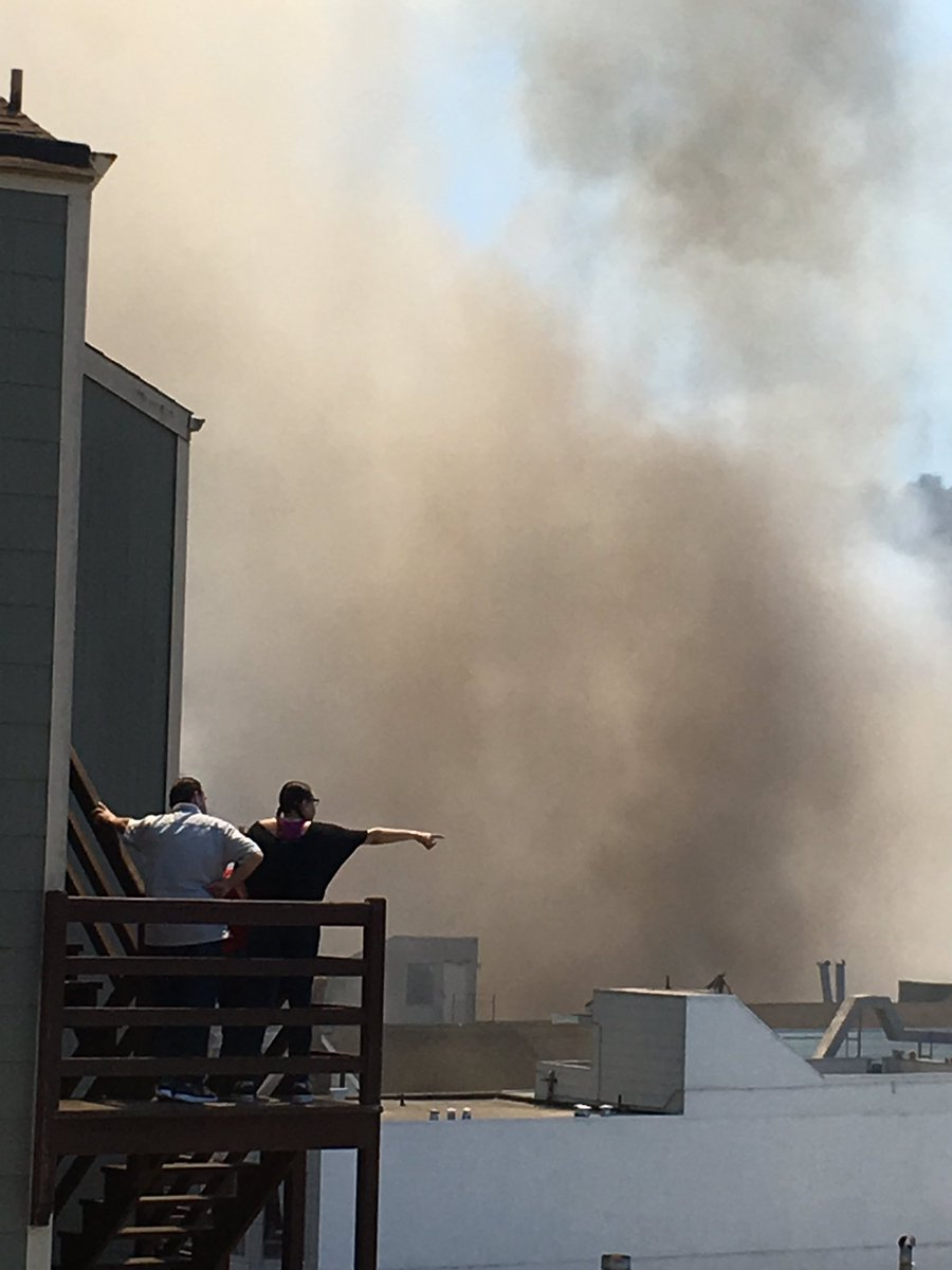 <div class='meta'><div class='origin-logo' data-origin='none'></div><span class='caption-text' data-credit='Photo submitted to KGO-TV by @mschirmersf/Twitter'>San Francisco firefighters are battling a 4-alarm fire on the 3300 block of Mission St. in Bernal Heights.</span></div>