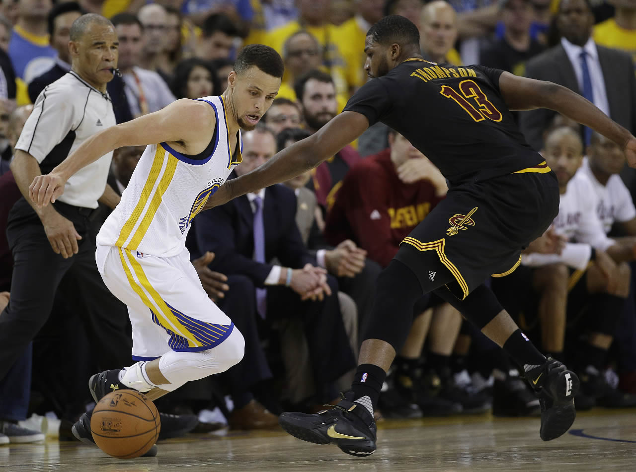 "<div class=""meta image-caption""><div class=""origin-logo origin-image none""><span>none</span></div><span class=""caption-text"">Golden State Warriors guard Stephen Curry dribbles against Cleveland Cavaliers Tristan Thompson in Game 7 of basketball's NBA Finals in Oakland, Calif., Sunday, June 19, 2016.  (AP Photo/Marcio Jose Sanchez)</span></div>"