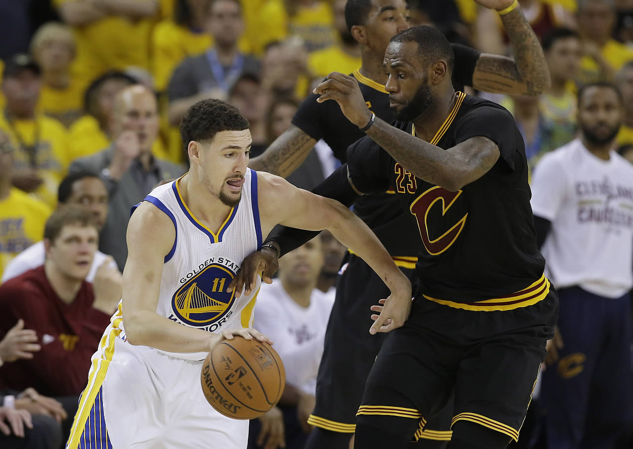 <div class='meta'><div class='origin-logo' data-origin='none'></div><span class='caption-text' data-credit='AP Photo/Marcio Jose Sanchez'>Golden State Warriors guard Klay Thompson dribbles against Cleveland Cavaliers LeBron James during the Game 7 of basketball's NBA Finals in Oakland, Calif., Sunday, June 19, 2016.</span></div>