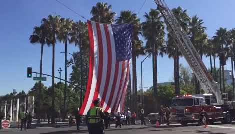 <div class='meta'><div class='origin-logo' data-origin='none'></div><span class='caption-text' data-credit='KGO-TV'>San Jose firefighters raise a flag in honor of SJPD Officer Michael Katherman on Tuesday, June 21, 2016.</span></div>