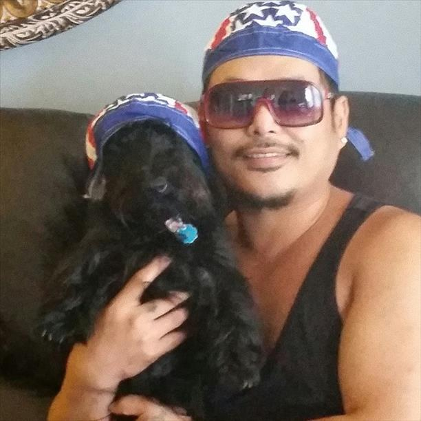 Molly, a purebred Scottish terrier, and Uncle Allan root for USA!  Keep sending in your World Cup fan photos!   <span class=meta>(photo submitted by A. Santos via uReport)</span>