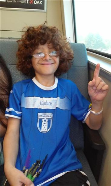 Marlon supporting Honduras and riding BART on his way to watch the USA game at the Civic Center. Keep sending in your World Cup fan photos! <span class=meta>(photo submitted by Jesenia Stewart via uReport)</span>