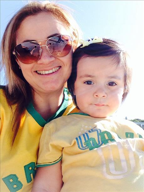 <div class='meta'><div class='origin-logo' data-origin='~ORIGIN~'></div><span class='caption-text' data-credit='photo submitted by duartel via uReport'>Mommy and baby Brazil fans!  Keep sending in your World Cup fan photos!</span></div>