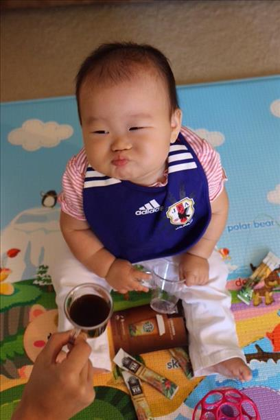 "<div class=""meta ""><span class=""caption-text "">8-month-old Arisa, team Japan, reacts to the game vs. Colombia. Keep sending in your World Cup fan photos! (photo submitted by Madoka Hirao via uReport)</span></div>"