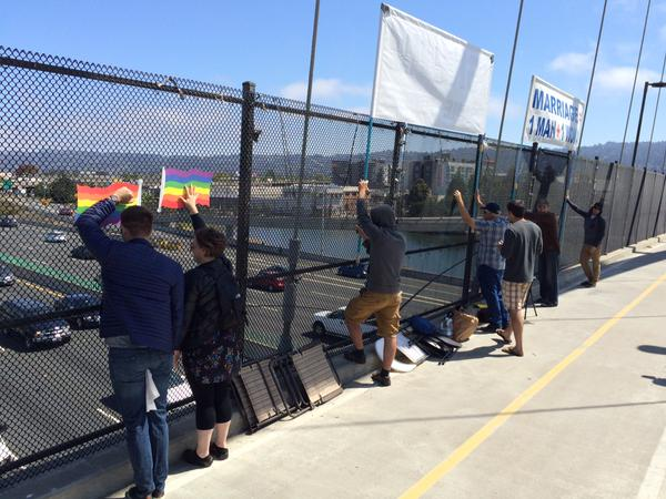 """<div class=""""meta image-caption""""><div class=""""origin-logo origin-image none""""><span>none</span></div><span class=""""caption-text"""">People hold pride signs up on a Berkeley overpass after SCOTUS ruling on same sex marriage on Friday, June 26, 2015. (KGO-TV)</span></div>"""