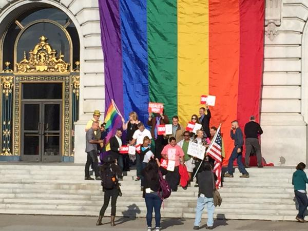 """<div class=""""meta image-caption""""><div class=""""origin-logo origin-image none""""><span>none</span></div><span class=""""caption-text"""">A dozen or so same sex couples gather under the Pride flag which was unfurled at San Francisco City Hall steps after SCOTUS decision on Friday, June 26, 2015. (KGO-TV)</span></div>"""