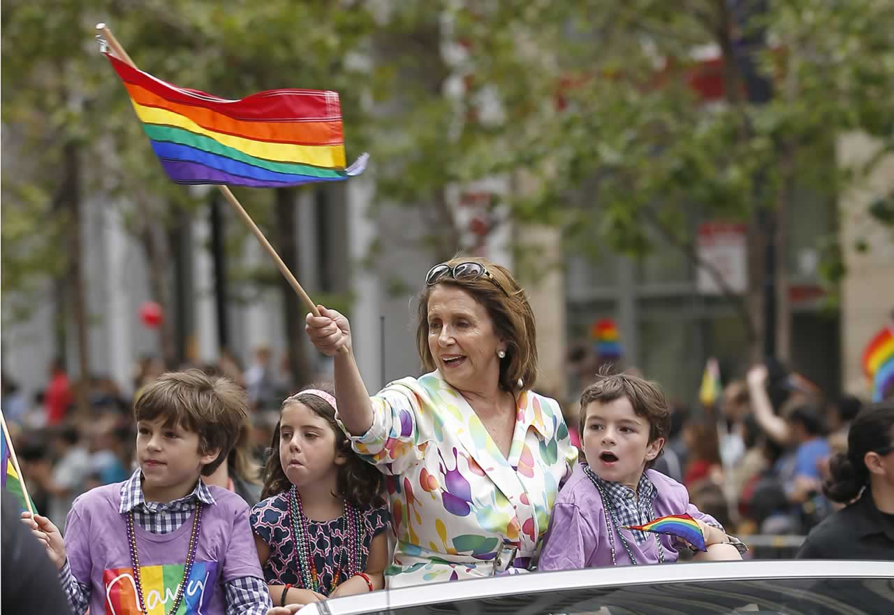 <div class='meta'><div class='origin-logo' data-origin='none'></div><span class='caption-text' data-credit='AP Photo/ Tony Avelar'>House Minority Leader Nancy Pelosi waves a rainbow flag while riding in the 45th annual San Francisco Gay Pride parade Sunday, June 28, 2015, in San Francisco.</span></div>