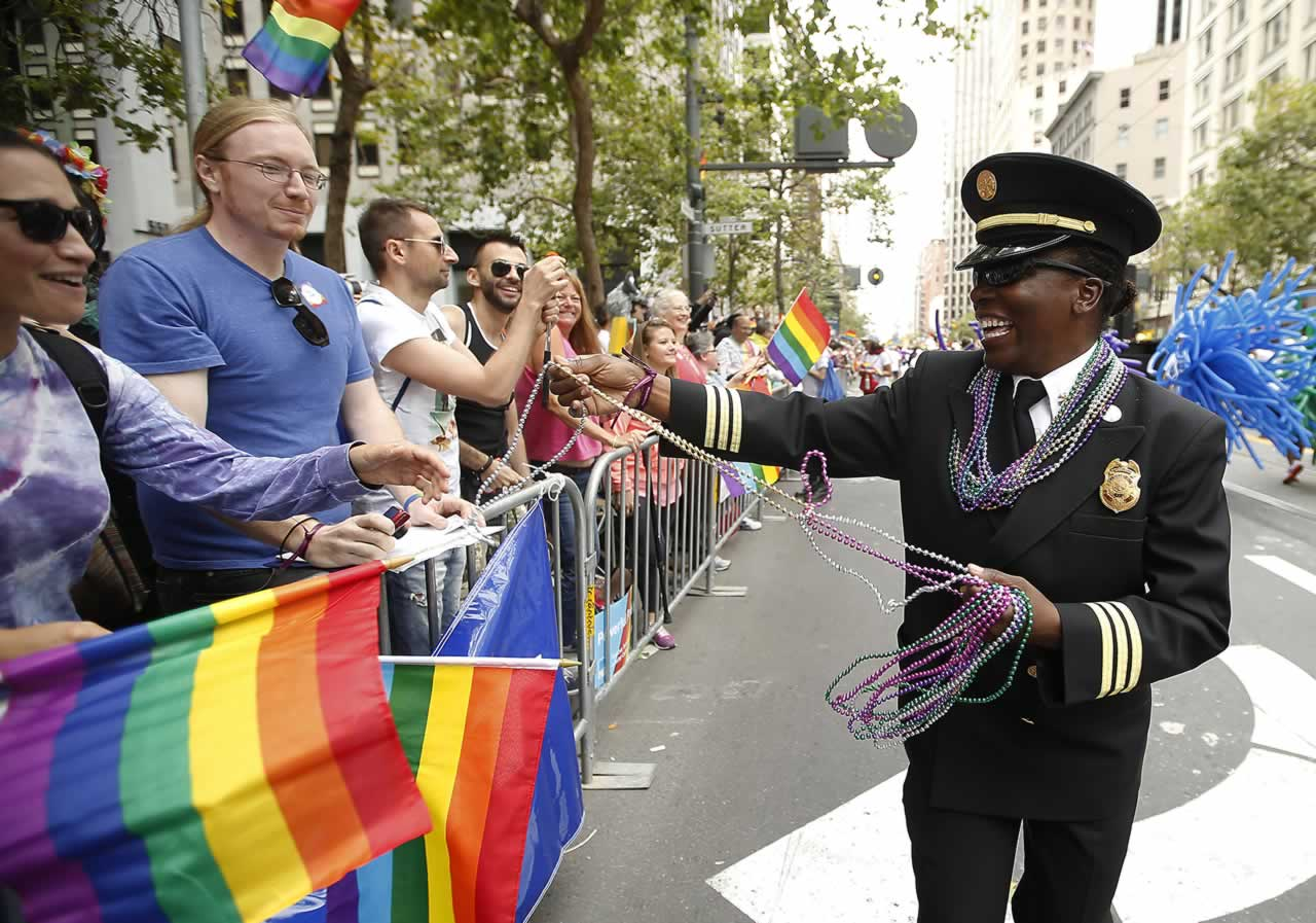<div class='meta'><div class='origin-logo' data-origin='none'></div><span class='caption-text' data-credit='AP Photo/ Tony Avelar'>SFFD's Deputy Chief Raemona Williams, right, passes out beaded necklaces to the crowd during the 45th annual San Francisco Gay Pride parade Sunday, June 28, 2015, in San Francisco.</span></div>