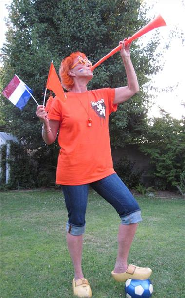 <div class='meta'><div class='origin-logo' data-origin='none'></div><span class='caption-text' data-credit='photo submitted via uReport'>Go Holland!  Keep sending in your World Cup fan photos!</span></div>