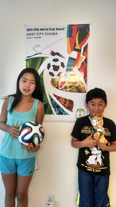 <div class='meta'><div class='origin-logo' data-origin='none'></div><span class='caption-text' data-credit='photo submitted via uReport'>Hannah and William have World Cup fever! Keep sending in your World Cup fan photos!</span></div>