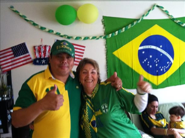 <div class='meta'><div class='origin-logo' data-origin='~ORIGIN~'></div><span class='caption-text' data-credit='photo submitted via uReport'>Big Brazil fans! Keep sending in your World Cup fan photos!</span></div>