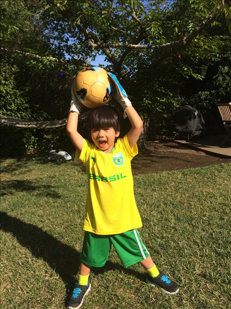 "<div class=""meta ""><span class=""caption-text "">4-year-old in full soccer gear rooting for Brazil! Keep sending in your World Cup fan photos! (photo submitted by Pam Chee via uReport)</span></div>"