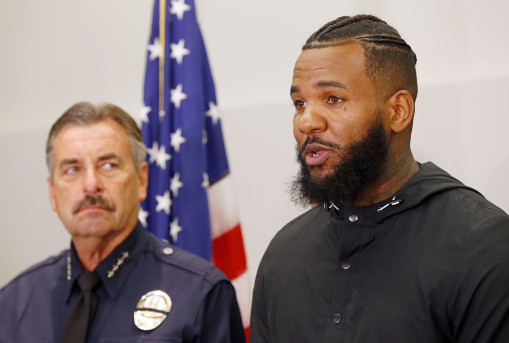 <div class='meta'><div class='origin-logo' data-origin='none'></div><span class='caption-text' data-credit='AP Photo/Nick Ut'>Los Angeles Police Chief Charlie Beck, left, listens as rapper The Game speaks at a news conference in Los Angeles Friday, July 8, 2016.</span></div>
