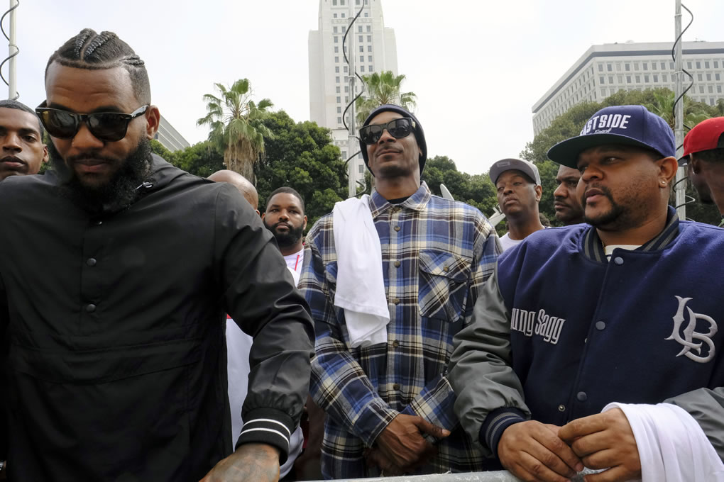 <div class='meta'><div class='origin-logo' data-origin='none'></div><span class='caption-text' data-credit='AP Photo/Richard Vogel'>Rappers The Game, left, and Snoop Dogg, center, appear at a peaceful unification march outside of an LAPD graduation ceremony in Los Angeles, Friday, July 8, 2016.</span></div>