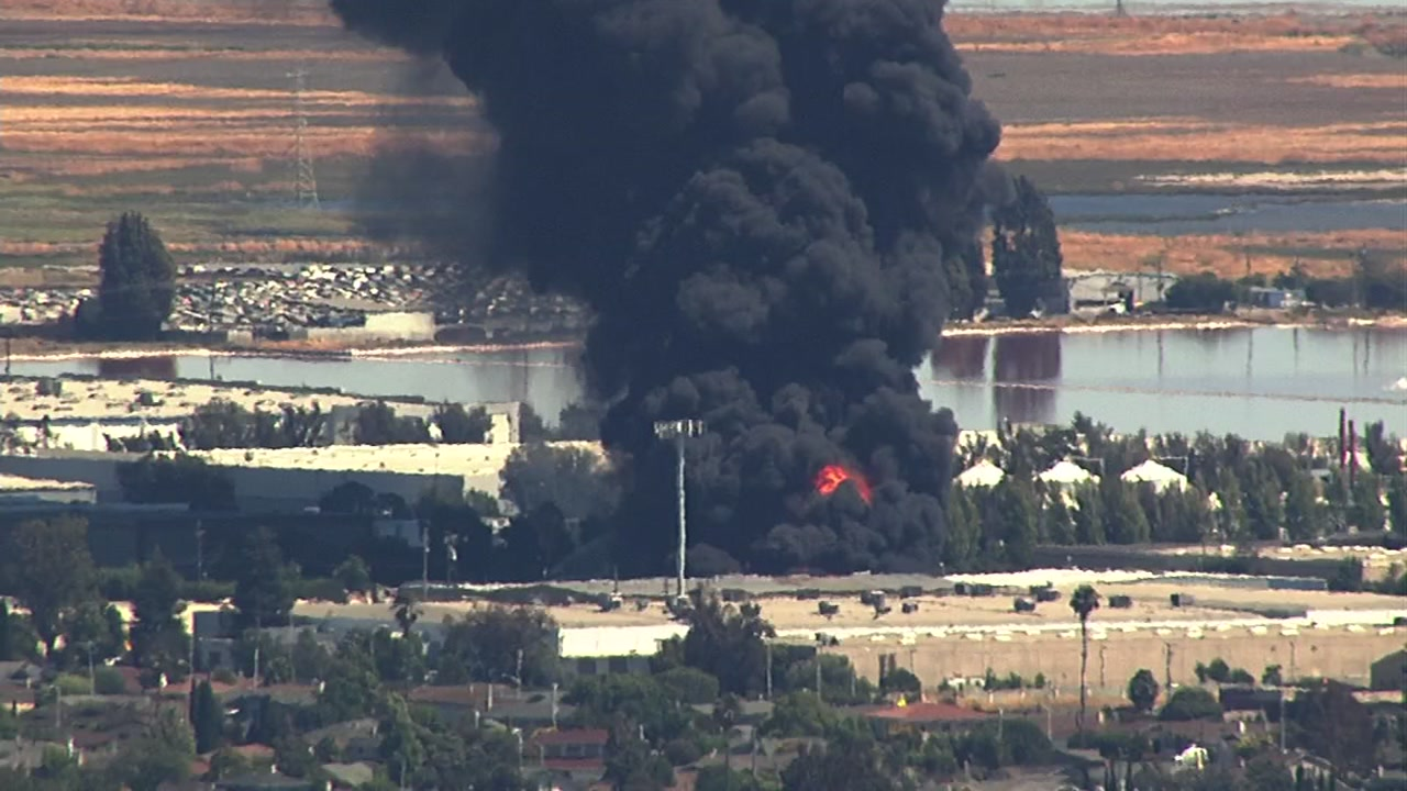 <div class='meta'><div class='origin-logo' data-origin='none'></div><span class='caption-text' data-credit='KGO-TV'>A massive fire burns at a recycling center in Newark, Calif., on Friday, June 8, 2016.</span></div>