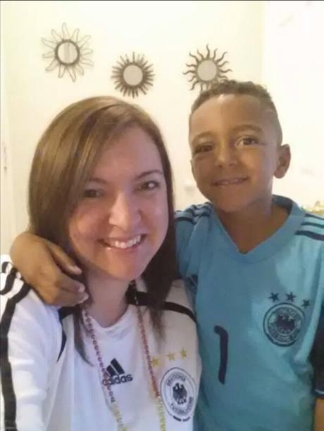 <div class='meta'><div class='origin-logo' data-origin='~ORIGIN~'></div><span class='caption-text' data-credit='photo submitted by Ela P. via uReport'>Mother and son root for Germany! Keep sending in your World Cup fan photos!</span></div>