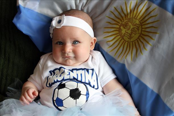 Baby Keira supporting Argentina!  Daddy is cheering for Germany...a household divided.  Keep sending in your World Cup fan photos! <span class=meta>(photo submitted by Mariela Orso via uReport)</span>