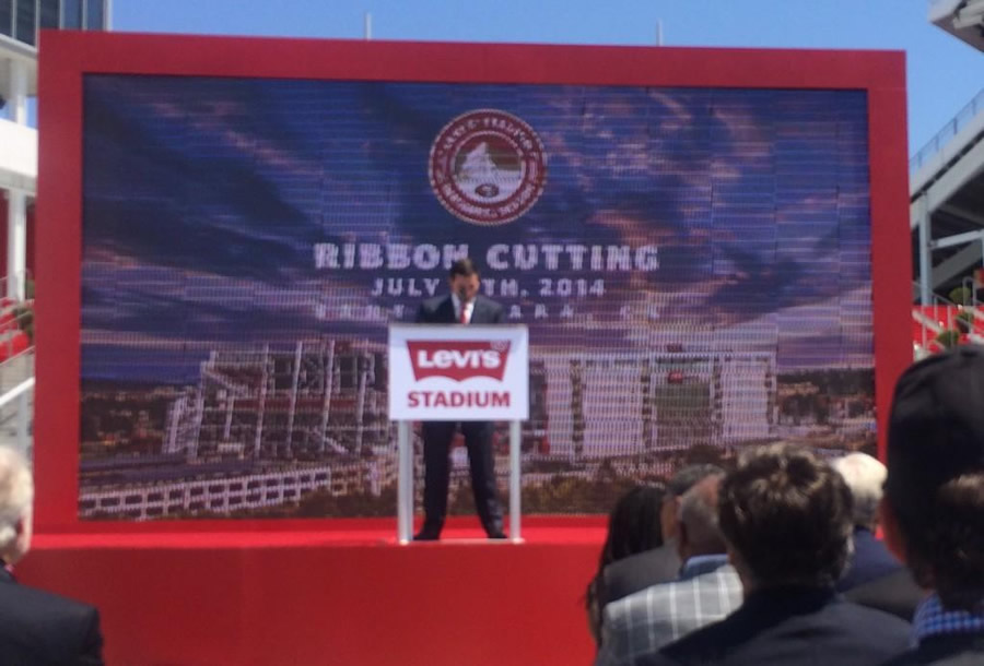 <div class='meta'><div class='origin-logo' data-origin='none'></div><span class='caption-text' data-credit='ABC7 News Reporter, David Louie'>Ribbon cutting day at Levi's Stadium!  An emotional 49ers CEO Jed York makes opening remarks.</span></div>