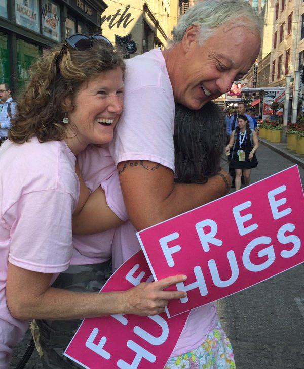 <div class='meta'><div class='origin-logo' data-origin='none'></div><span class='caption-text' data-credit='KGO-TV'>A group of people are seen hugging outside the Republican National Convention in Cleveland, Ohio on Wednesday, July 20, 2016.</span></div>