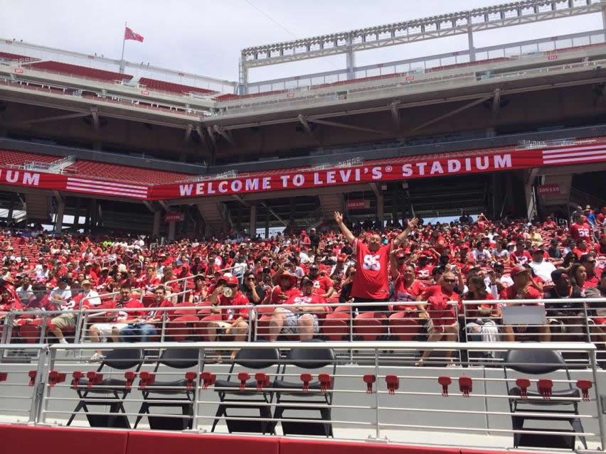 <div class='meta'><div class='origin-logo' data-origin='none'></div><span class='caption-text' data-credit='@MikeShumann'>Thousands of die-hard fans act like it's a game at the first 49er practice in Levi's Stadium.</span></div>