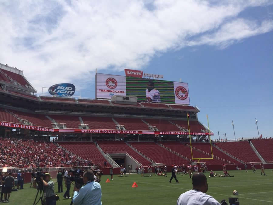 The Levi's Stadium scoreboard is awesome.  Thousands of die-hard fans watch the 49ers practice at their impressive new home. <span class=meta>@MikeShumann</span>