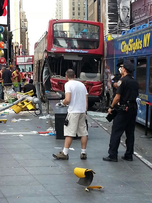 "<div class=""meta image-caption""><div class=""origin-logo origin-image ""><span></span></div><span class=""caption-text"">Two double-decker tour buses crashed in New York's Times Square. (Photo courtesy Sirena)</span></div>"