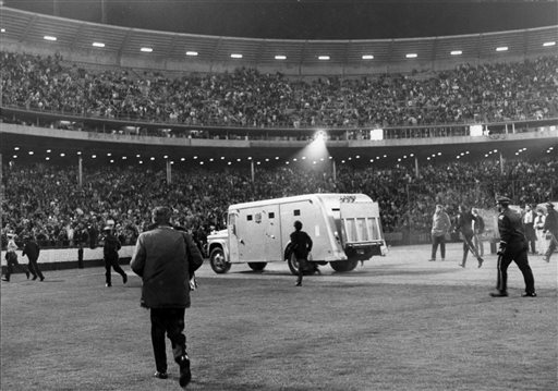 <div class='meta'><div class='origin-logo' data-origin='~ORIGIN~'></div><span class='caption-text' data-credit='Fred Pardini'>In this photo taken Aug. 29, 1966, the Beatles are driven away in an armored car after performing at Candlestick Park in San Francisco.</span></div>