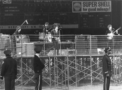 In this photo taken Aug. 29, 1966, spectators watch the Beatles perform at Candlestick Park in San Francisco. <span class=meta>Fred Pardini</span>