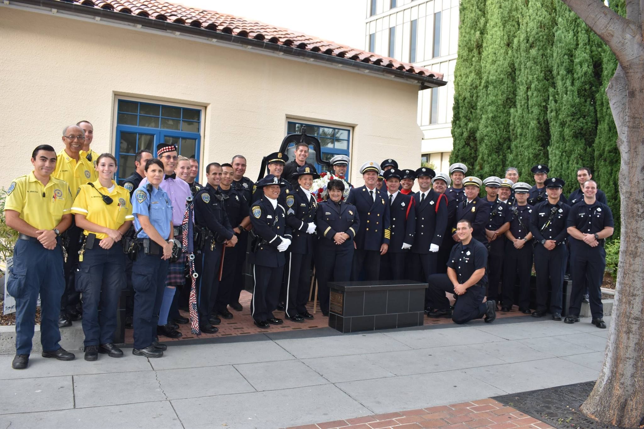 <div class='meta'><div class='origin-logo' data-origin='none'></div><span class='caption-text' data-credit='San Mateo Police Department/Facebook'>Members of the police and fire department joined together at Fire Station 21 in San Mateo, Calif. on Monday, Sept. 11, 2017 to pay tribute to the victims of 9/11.</span></div>