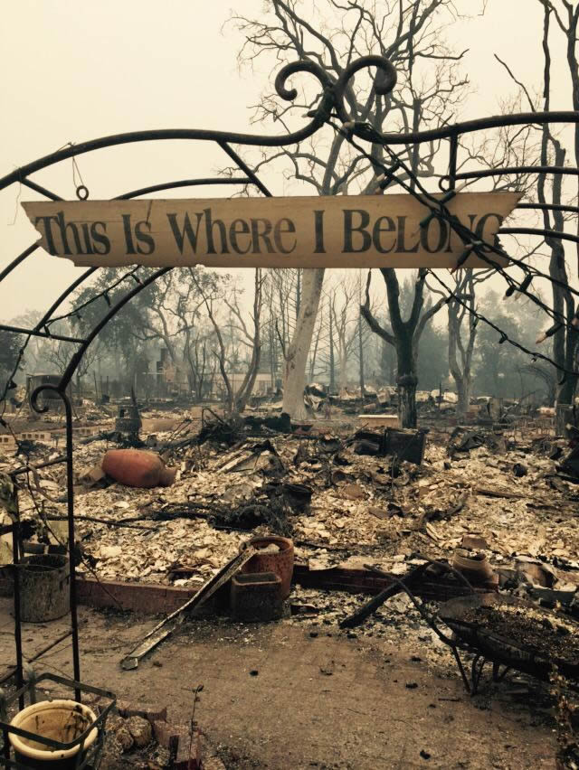 "<div class=""meta image-caption""><div class=""origin-logo origin-image none""><span>none</span></div><span class=""caption-text"">A sign that says ""This is where I belong"" hangs above a home that was destroyed in Middleton, Calif. is seen on Sunday, September 13, 2015. (Cornell Barnard/KGO-TV)</span></div>"