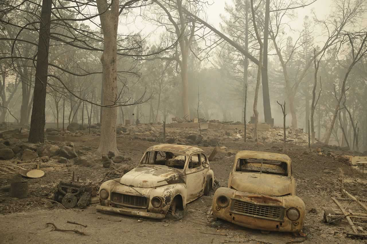 <div class='meta'><div class='origin-logo' data-origin='none'></div><span class='caption-text' data-credit='AP Photo/Eric Risberg'>A pair of burned cars sit outside the remains of several homes destroyed by fire along Highway 175, Sunday, Sept. 13, 2015, near Middletown, Calif.</span></div>