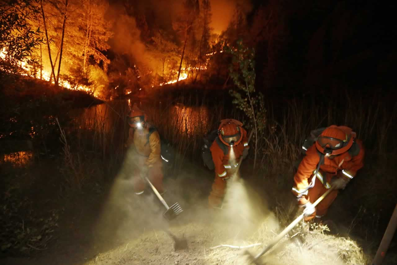 <div class='meta'><div class='origin-logo' data-origin='none'></div><span class='caption-text' data-credit='AP Photo/Elaine Thompson'>Firefighters create a firebreak near a home in Middletown, Calif., on Sunday, Sept. 13, 2015.</span></div>