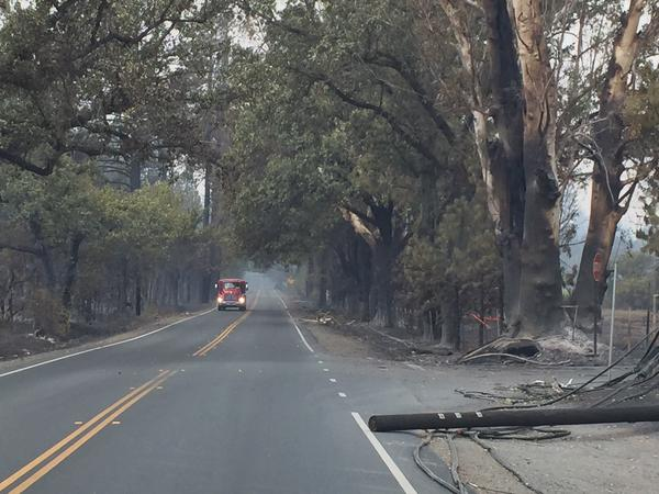 <div class='meta'><div class='origin-logo' data-origin='none'></div><span class='caption-text' data-credit='KGO-TV'>Highway 175 headed through Middletown, Calif. was blocked by PG&E crews on Monday, September 14, 2015.</span></div>