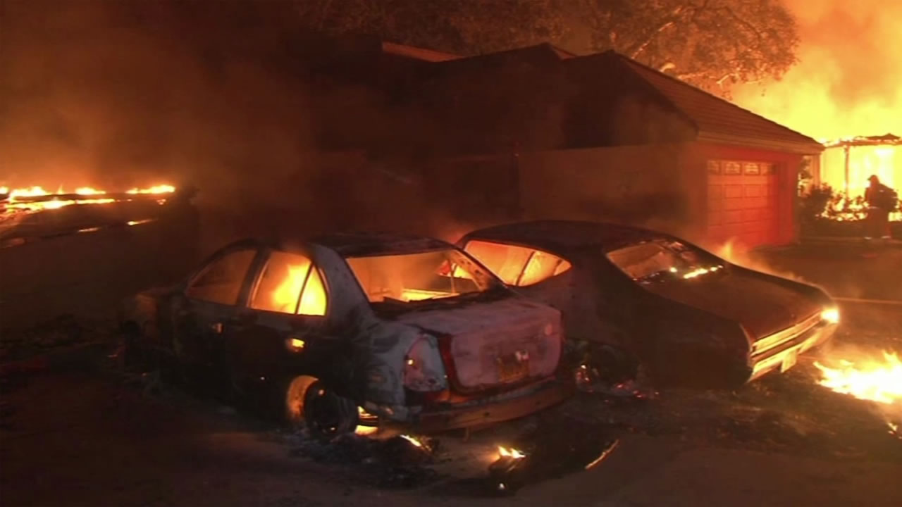 <div class='meta'><div class='origin-logo' data-origin='none'></div><span class='caption-text' data-credit='KGO-TV'>Cars and a home burns in Middleton, Calif. Sunday, September 13, 2015.</span></div>