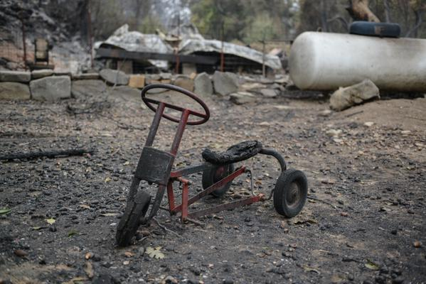 <div class='meta'><div class='origin-logo' data-origin='none'></div><span class='caption-text' data-credit='KGO-TV'>A burned bicycle sits across from Anderson Springs on Highway 175 on Monday, September 14, 2015 after the Valley Fire ripped through the area.</span></div>