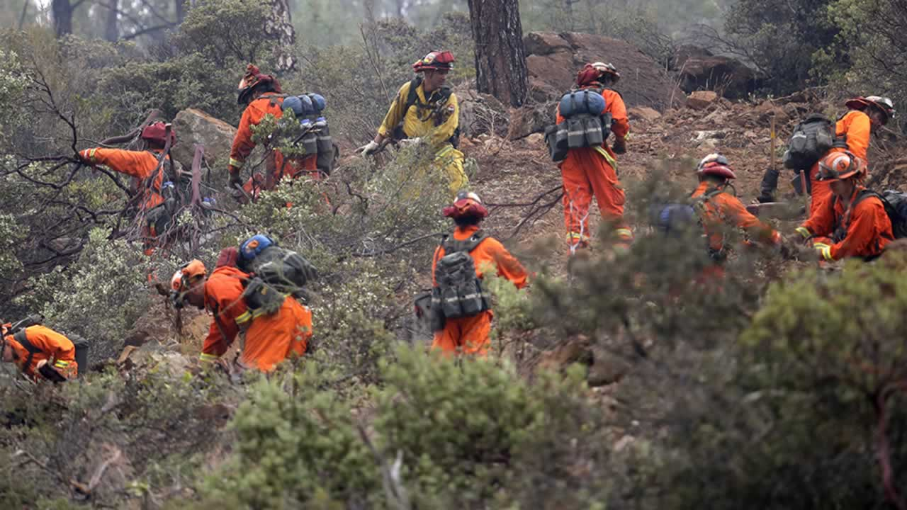 <div class='meta'><div class='origin-logo' data-origin='none'></div><span class='caption-text' data-credit='AP Photo/Elaine Thompson'>Firefighters work on a ridge line as they clear brush Monday, Sept. 14, 2015, near Middletown, Calif.</span></div>