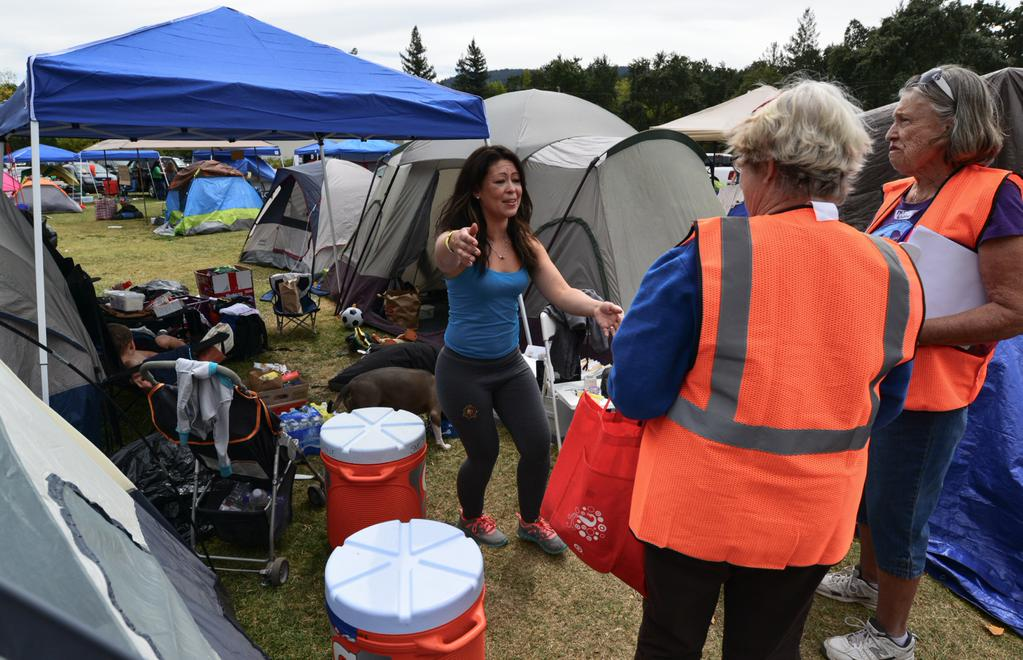 <div class='meta'><div class='origin-logo' data-origin='none'></div><span class='caption-text' data-credit='KGO-TV'>Valley Fire evacuees show their gratitude for volunteers at the Napa County Fairgrounds in Calistoga, Calif. on Tuesday, September 15, 2015.</span></div>