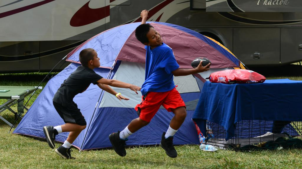 <div class='meta'><div class='origin-logo' data-origin='none'></div><span class='caption-text' data-credit='KGO-TV'>Children play near evacuee tents set up at the Napa County Fairgrounds in Calistoga, Calif. on Tuesday, September 15, 2015.</span></div>