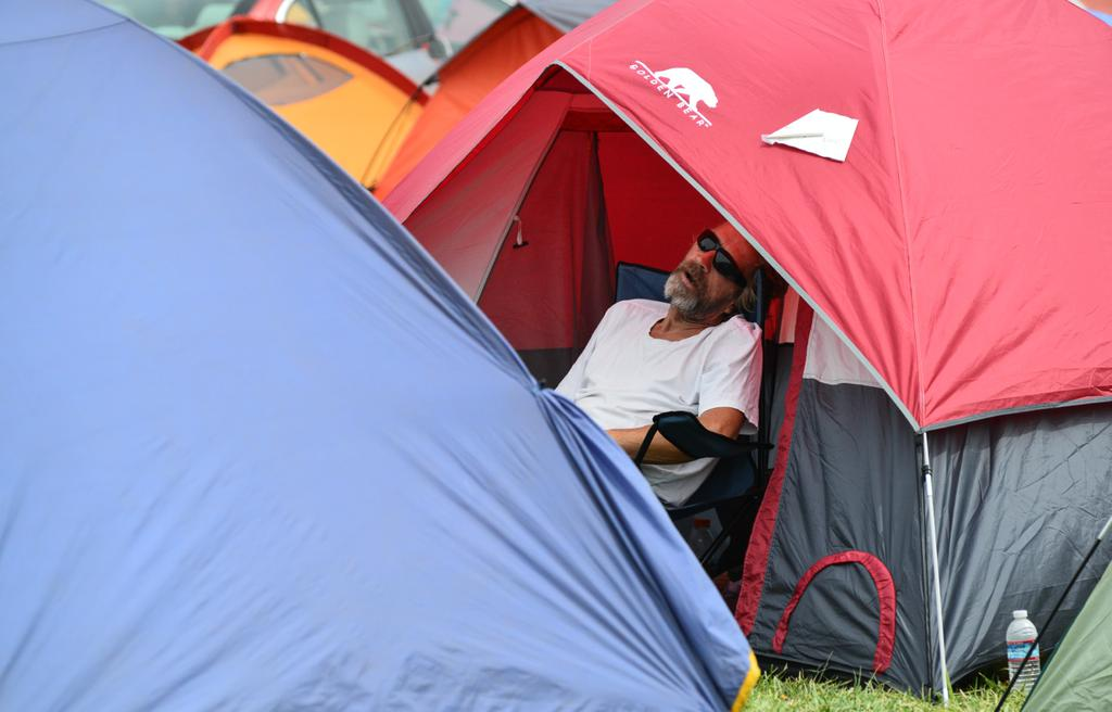 <div class='meta'><div class='origin-logo' data-origin='none'></div><span class='caption-text' data-credit='KGO-TV'>A Valley Fire evacuee sleeps outside a tent pitched at the Napa County Fairgrounds on Tuesday, September 15, 2015.</span></div>
