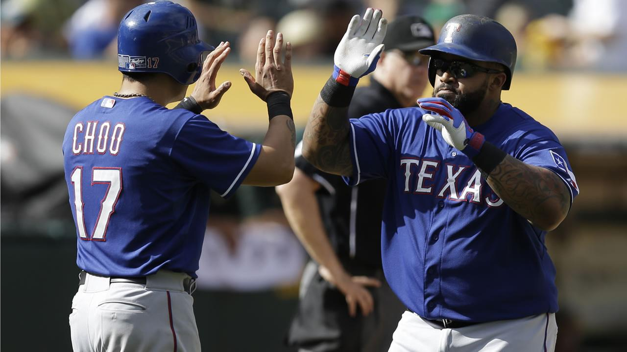 Rangers Prince Fielder celebrates with Shin-Soo Choo after hitting a two run home run off Athletics Cody Martin during a game on Sept. 24, 2015, in Oakland, Calif. (AP Photo)