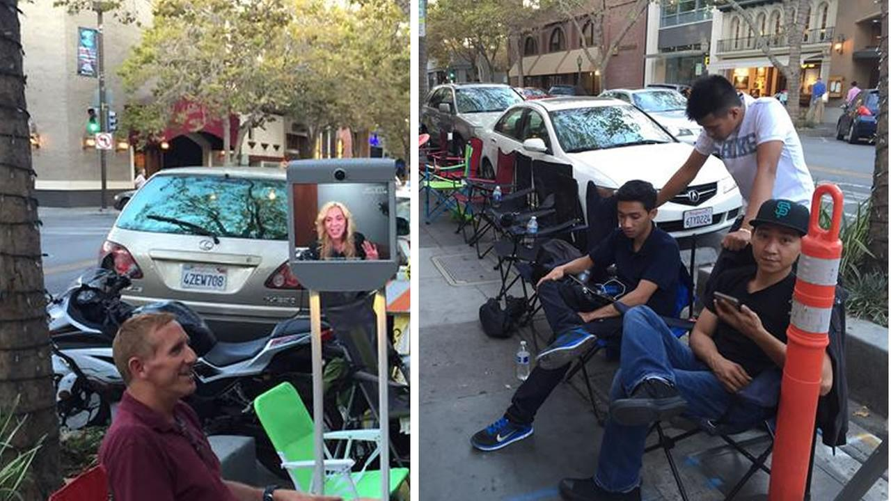 Customers and a robot waited in line for the new iPhone 6s in Palo Alto that comes out Sept. 25, 2015.