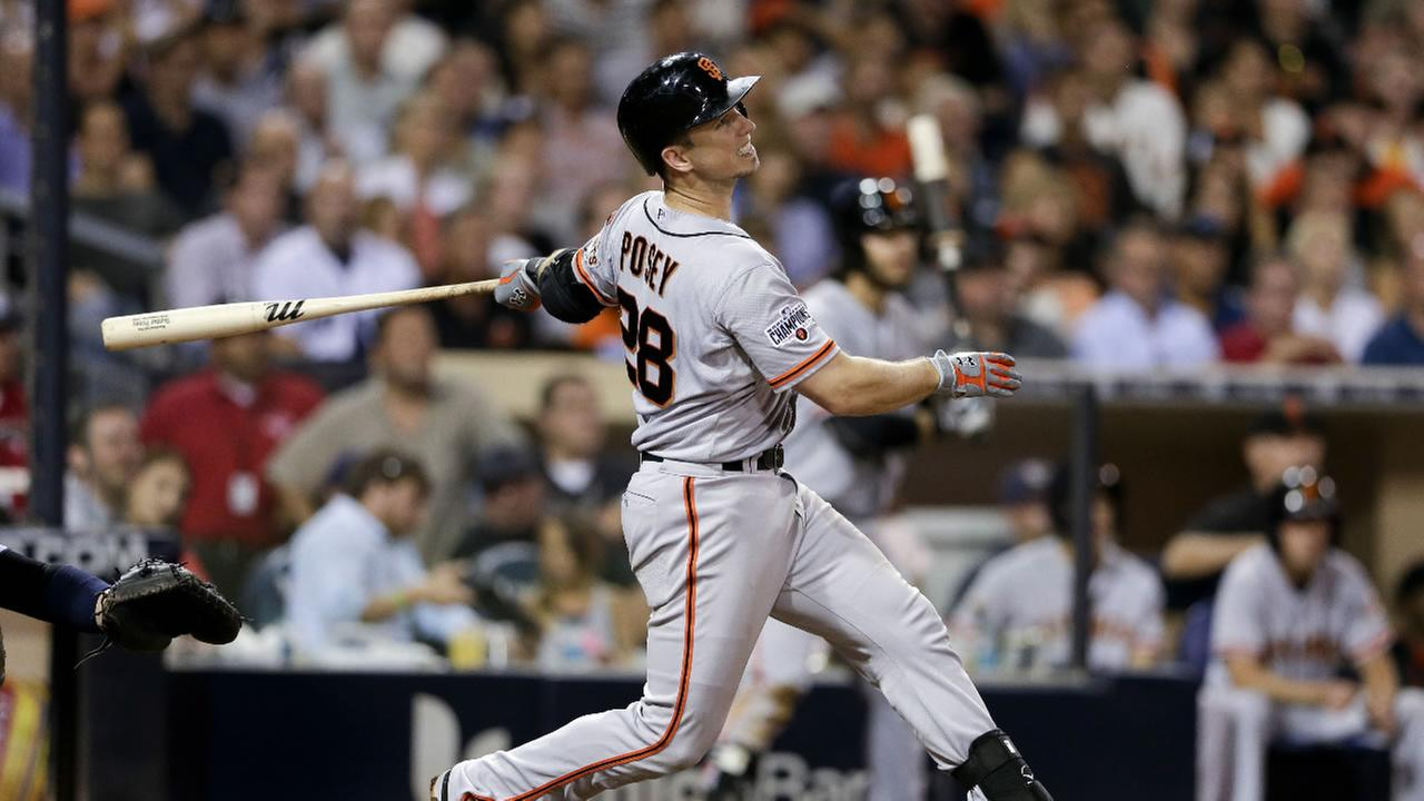San Francisco Giants Buster Posey flies out against the San Diego Padres with the score tied to end the top of the ninth inning of a baseball game  Thursday, Sept. 24, 2015.