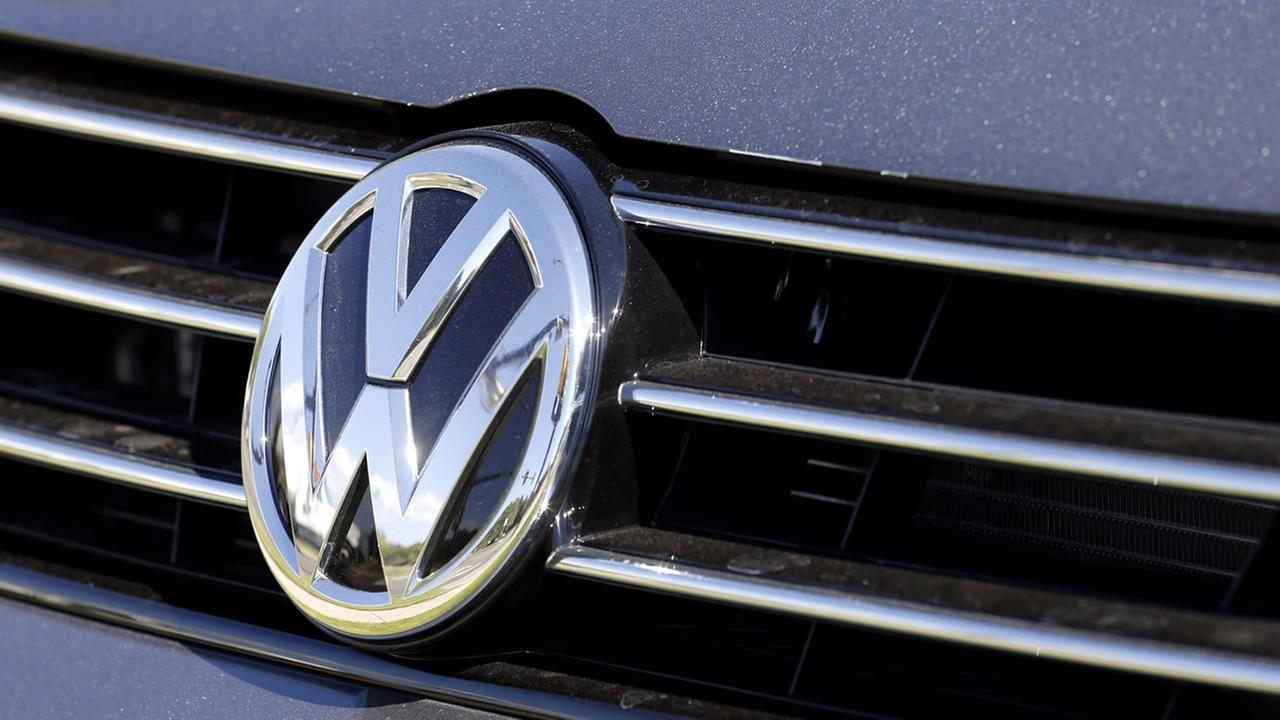 The grille of a Volkswagen car for sale is decorated with the iconic company symbol at a VW dealership in Boulder, Colo., Thursday, Sept. 24, 2015.