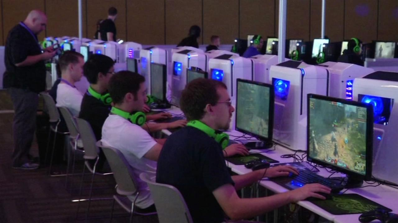People play and broadcast themeselves on video games at the first ever TwitchCon in San Francisco Sept. 25, 2015.