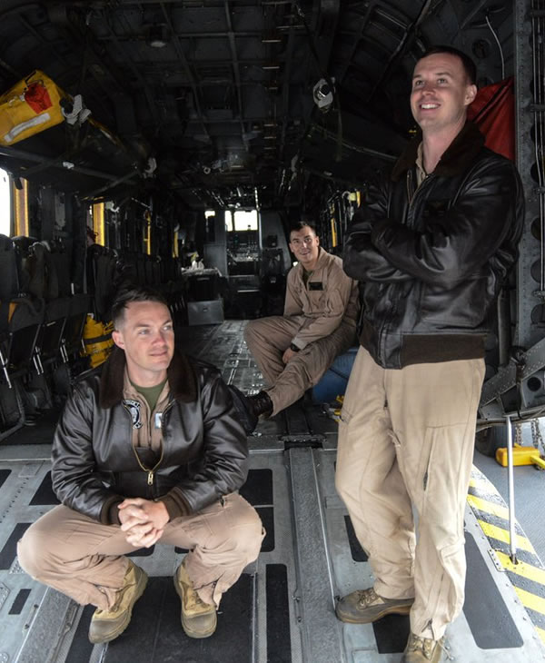 <div class='meta'><div class='origin-logo' data-origin='none'></div><span class='caption-text' data-credit='Wayne Freedman/KGO-TV'>Marine airmen stay out of the rain in the back of their helicopter on the USS San Diego on Monday, Oct. 3, 2016.</span></div>
