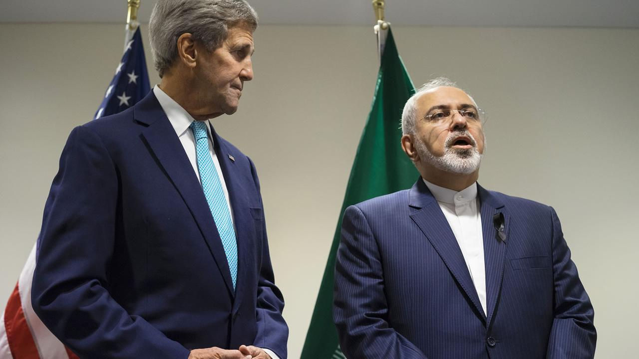 US Secretary of State John Kerry, left, listens as he meets with Iranian Foreign Minister Mohammad Javad Zarif at United Nations headquarters Saturday, Sept. 26, 2015.