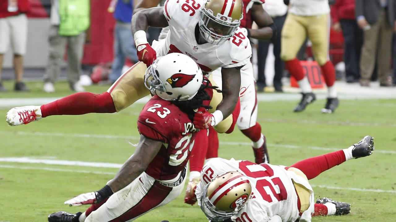 Cardinals running back Chris Johnson is hit by 49ers Tramaine Brock during a game on Sunday, Sept. 27, 2015, in Glendale, Ariz. (AP Photo/Ross D. Franklin)