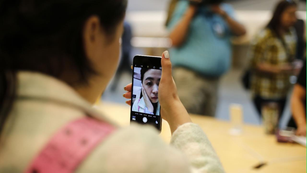 A customer tries out the new Apple iPhone 6S at an Apple store on Chicagos Magnificent Mile, Friday, Sept. 25, 2015, in Chicago.